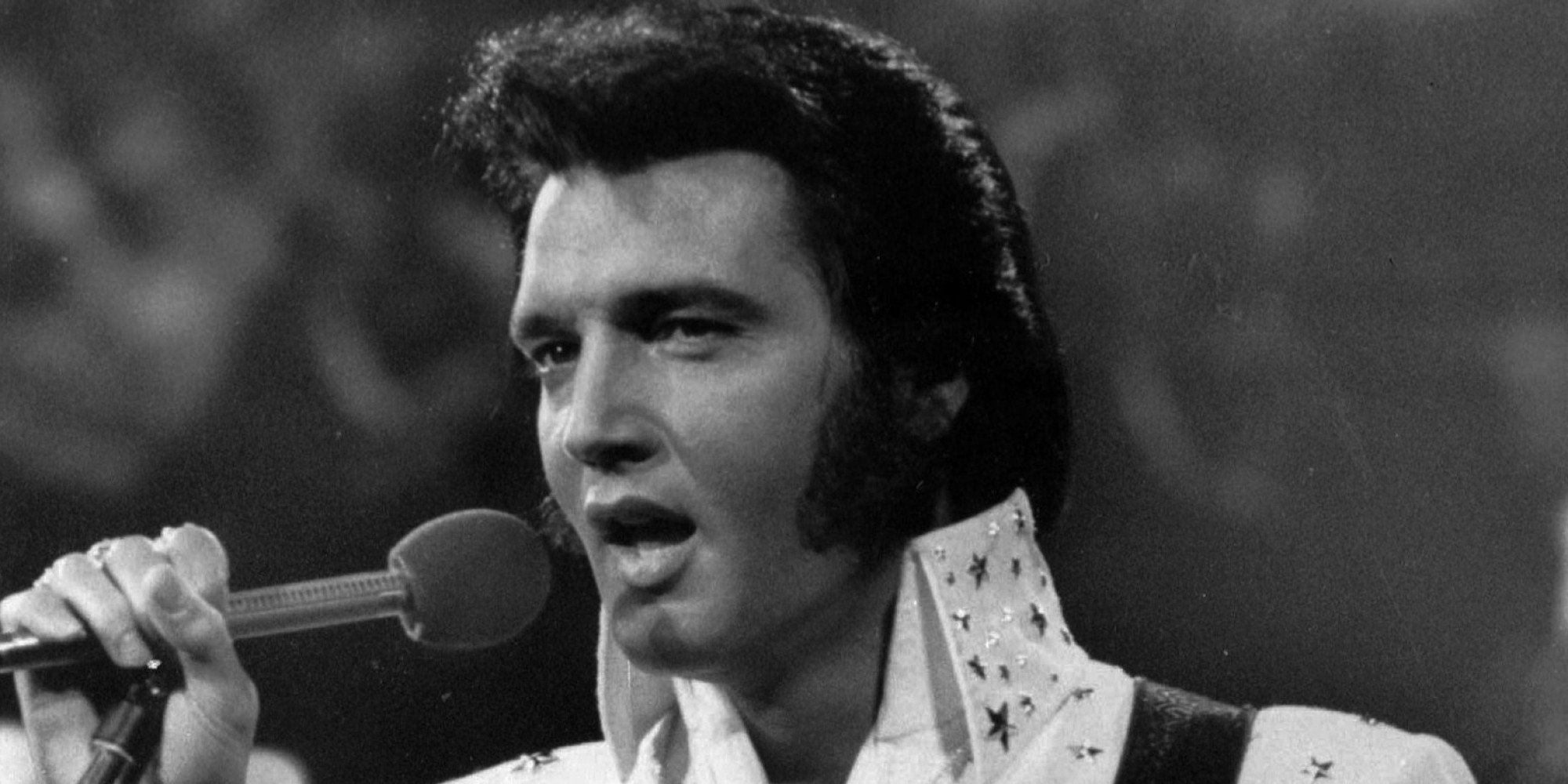** FILE ** Elvis Presley is shown in concert in the later part of his career. Wade Jones, a fan of Elvis Presley, auctioned three tablespoons of water, but not the cup, from a 1977 Presley concert on the Internet auction site eBay this weekend. (AP Photo/File)